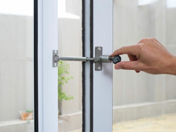 Locking patio glass door open with LockLatch